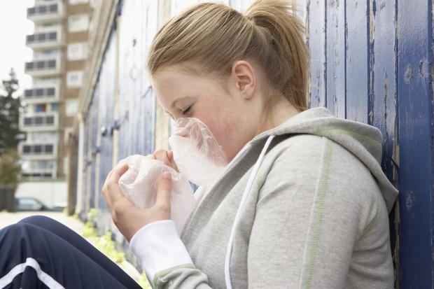 Teenage girl inhaling drugs